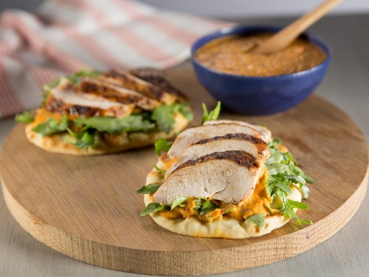 Spice Rubbed Chicken Breast on Toasted Pita with Piquillo White Bean Hummus and Arugula Salad